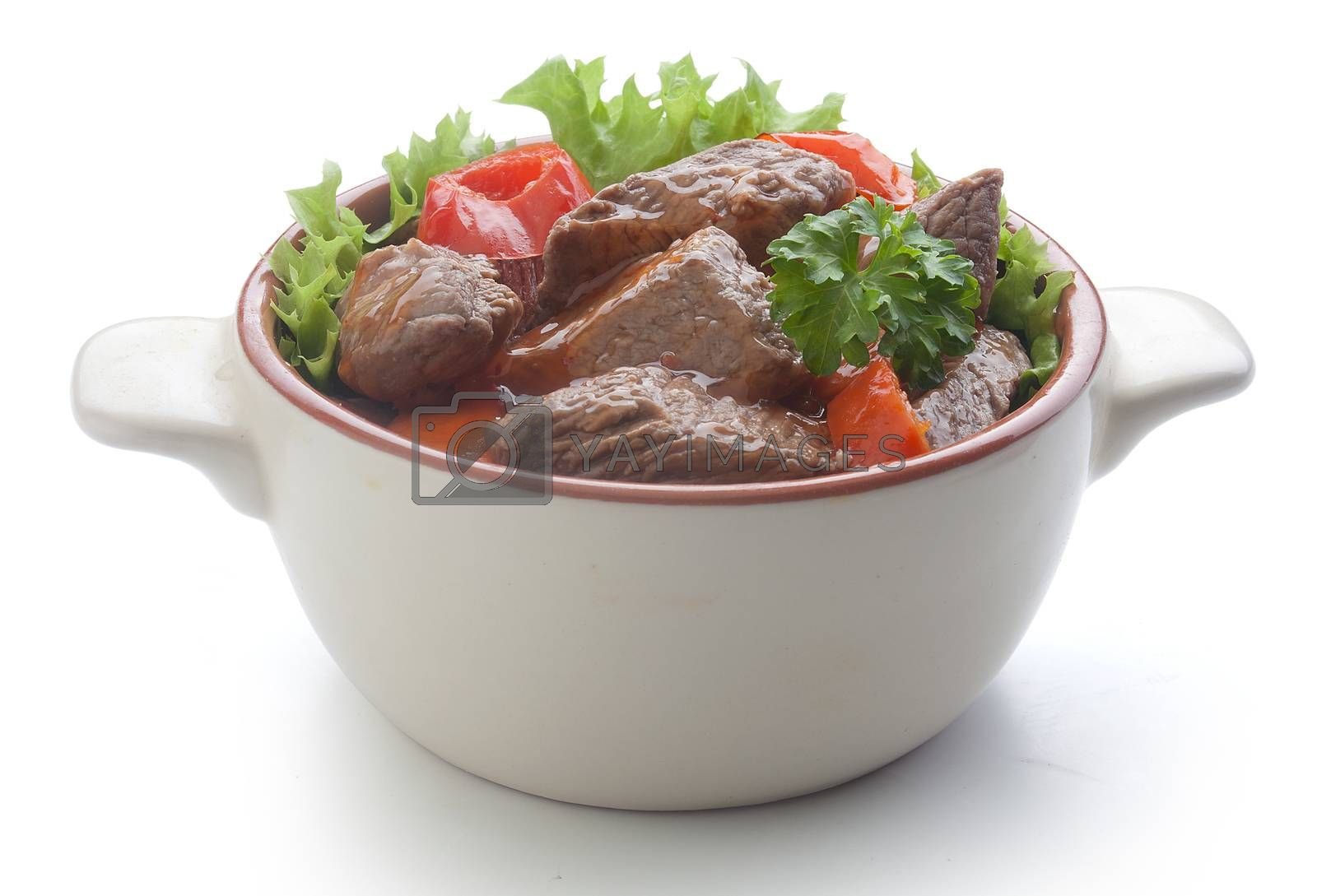 Royalty free image of Beef goulash with lettuce in the rural bowl by Angorius
