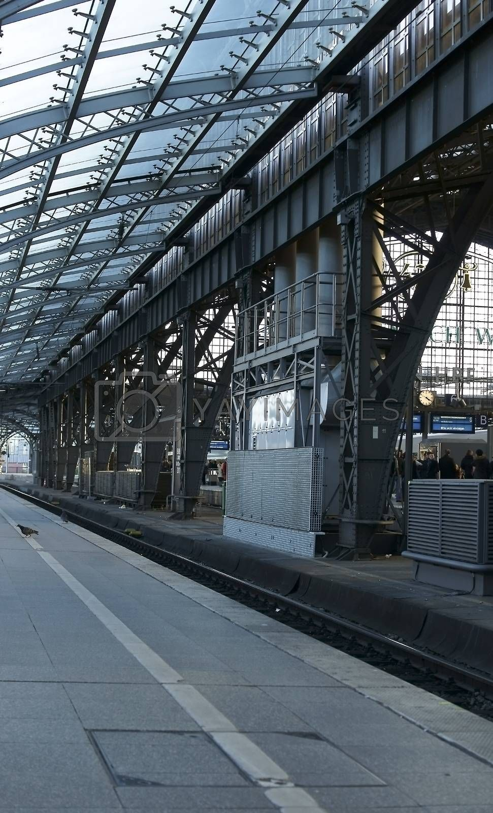 Cologne, Germany - February 02, 2014: The Indoors o a platform of the Cologne central station with a glass canopy on February 02, 2014 in Cologne.