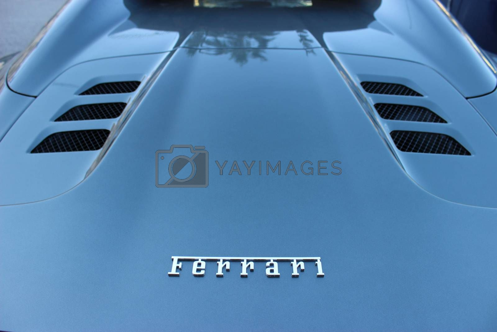 Royalty free image of Logo of Ferrari on a Cowl by bensib