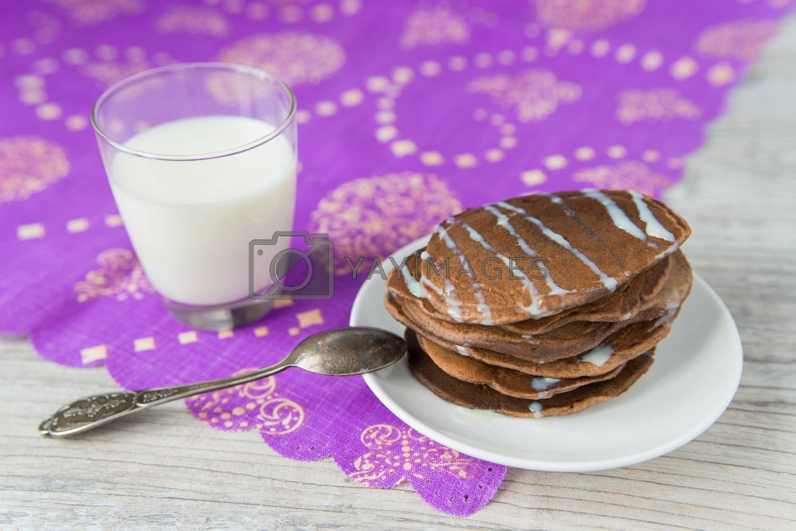 Royalty free image of Chocolate pancakes with milk by Linaga