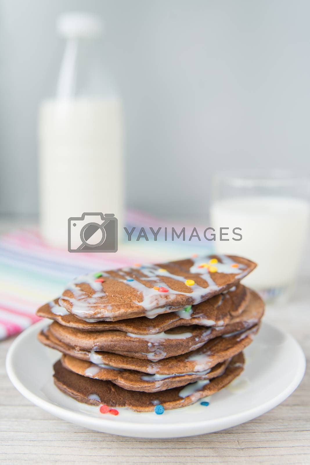 Royalty free image of Decorated chocolate pancakes with milk by Linaga