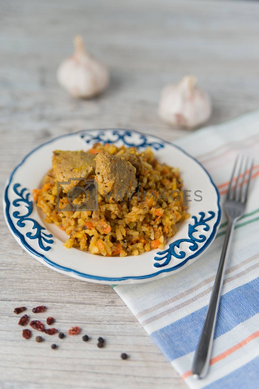 Plate of rice and meat dish pilau by Linaga