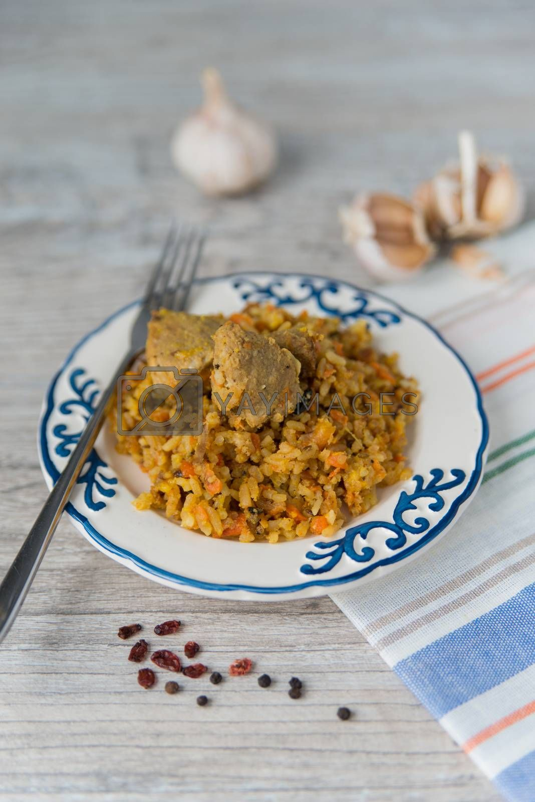 Royalty free image of Plate of rice and meat dish pilau by Linaga