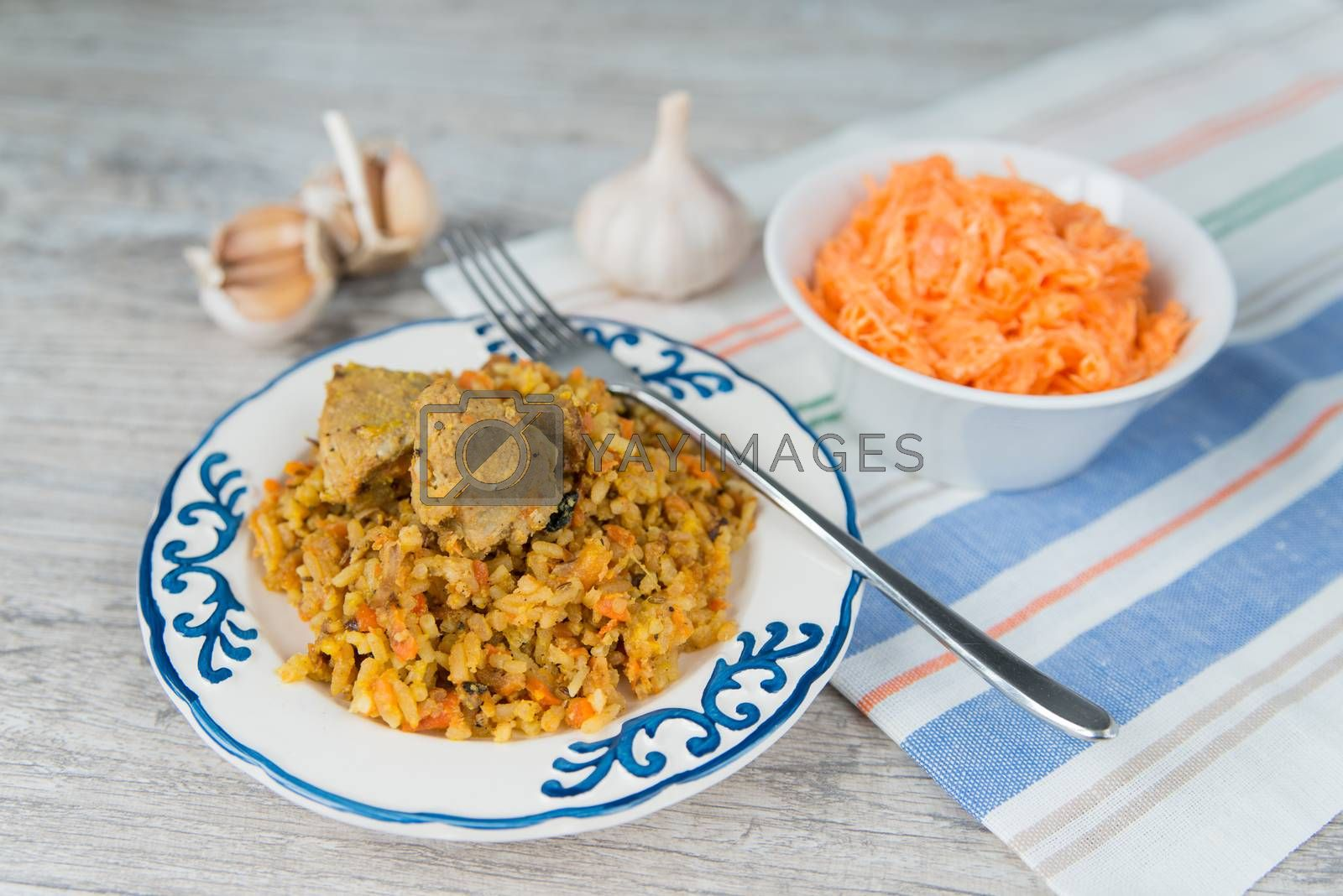 Royalty free image of Plate of rice and meat dish pilau and carrot salad by Linaga