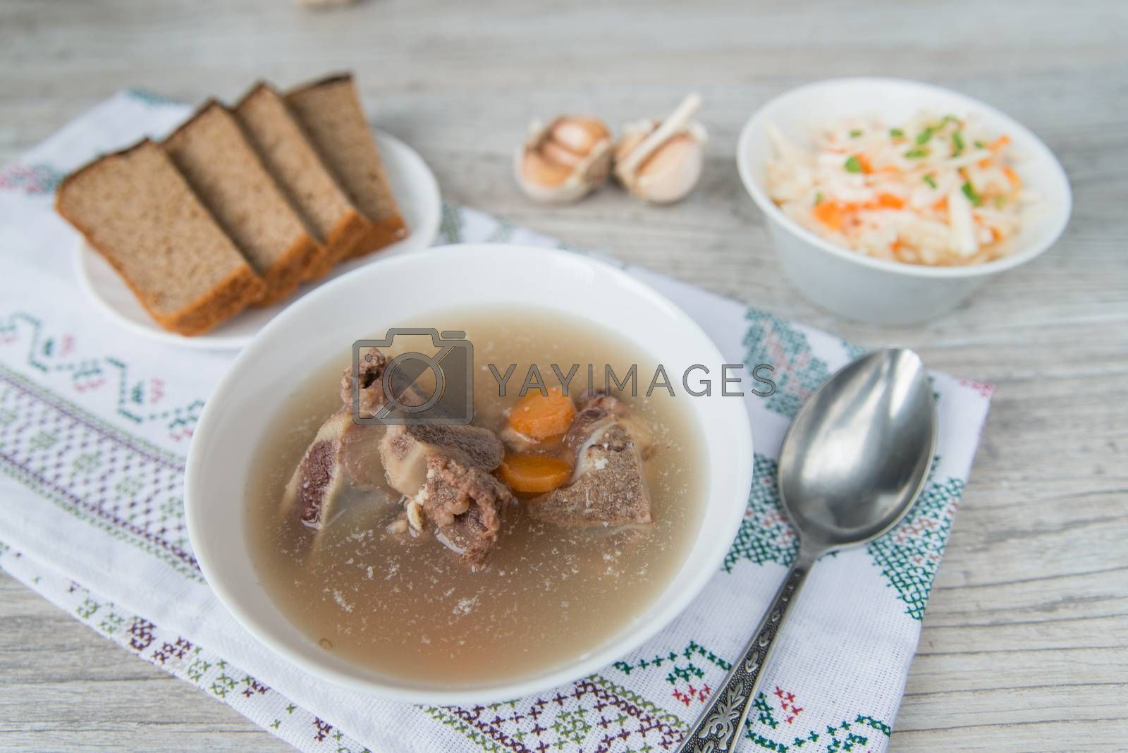 Royalty free image of Dinner with the bouillon and sauerkraut by Linaga