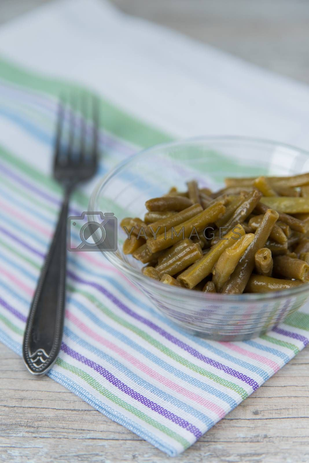 Royalty free image of Plate of the green beans and fork by Linaga