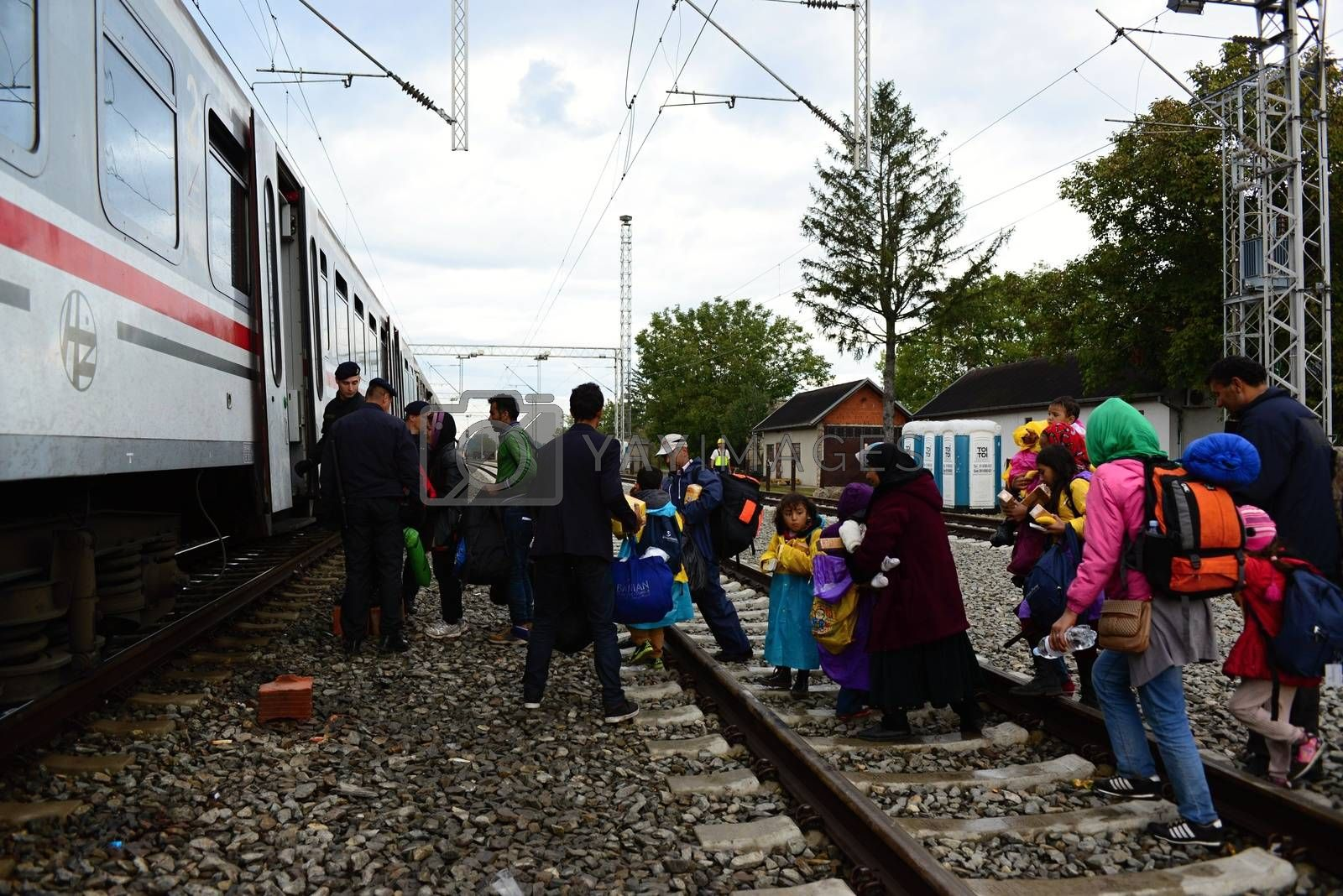 Royalty free image of refugees leaving Hungary by radekprocyk