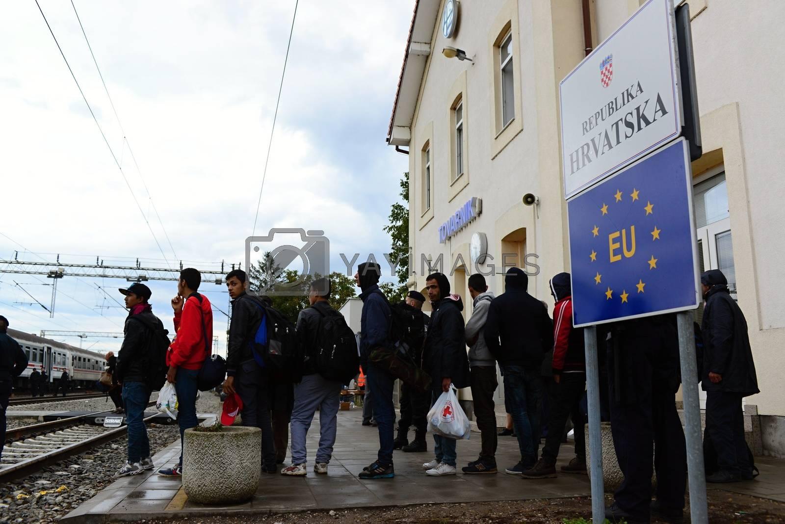 Royalty free image of refugees leaving Hungary by radekprocyk