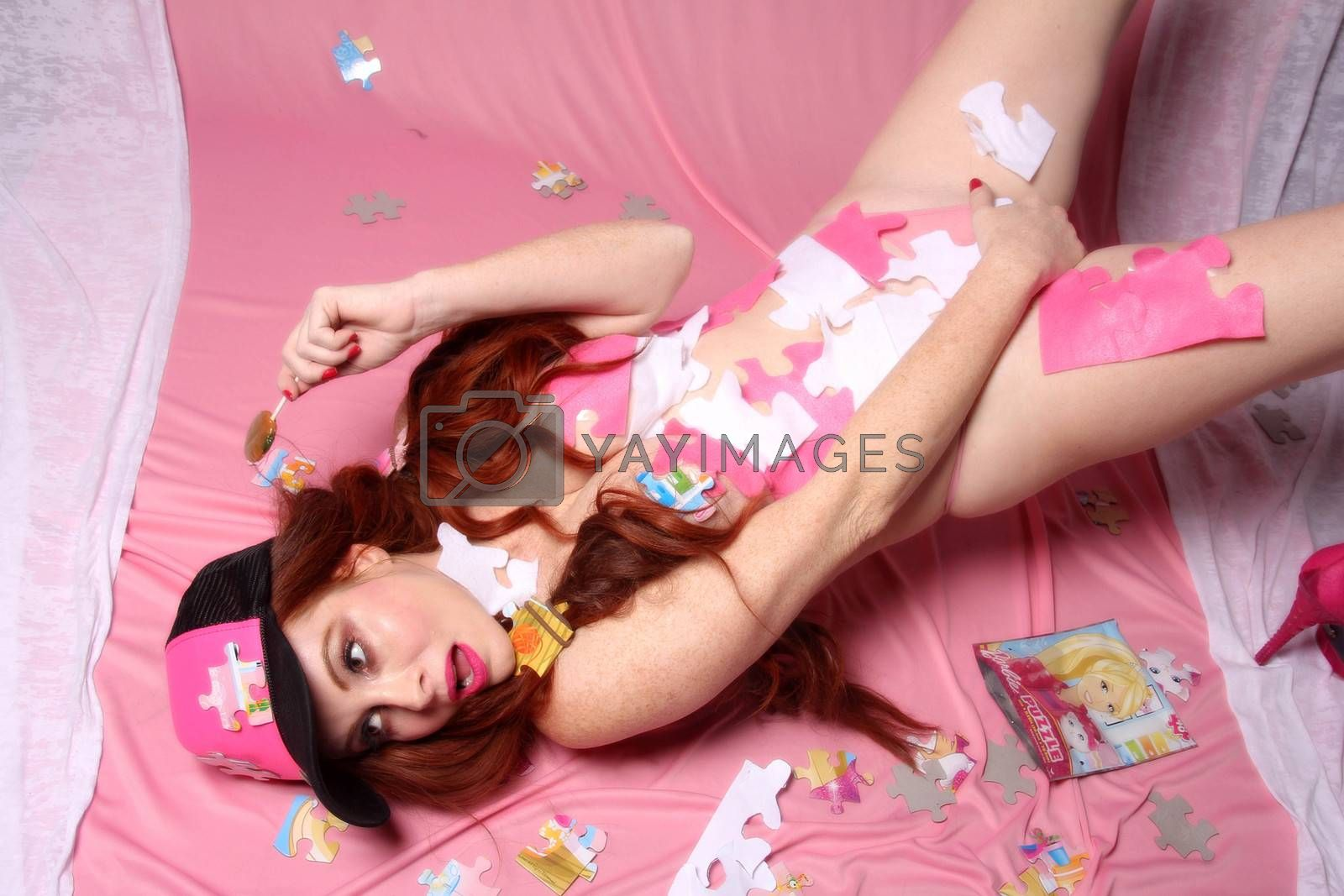Royalty free image of Phoebe Price celebrates National Puzzle Day (Jan 29) in her own naked fashion, Los Angeles, CA 01-29-16/ImageCollect by ImageCollect
