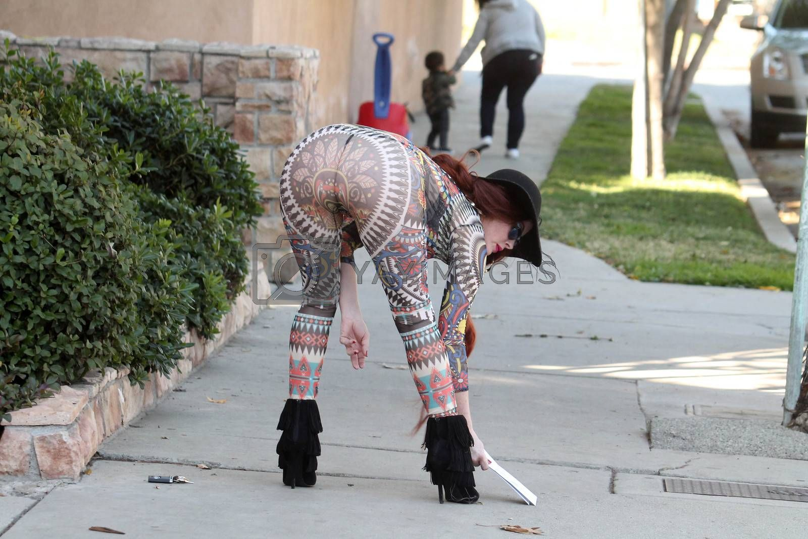 Royalty free image of Phoebe Price sighting wearing a see-thru outfit while getting her mail, Los Angeles, CA 01-28-16/ImageCollect by ImageCollect