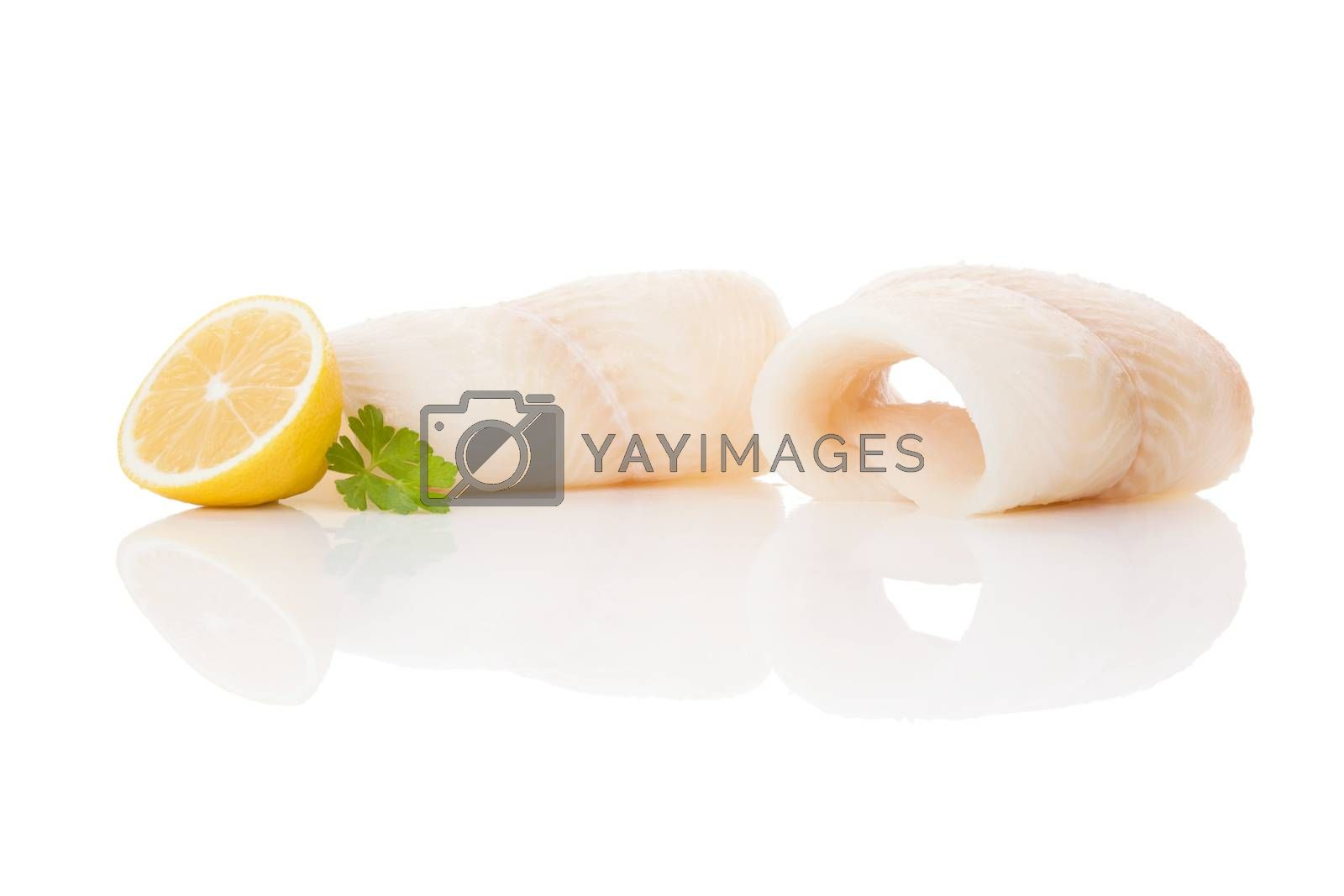 Raw fresh halibut steak isolated on white background. Culinary healthy seafood eating.