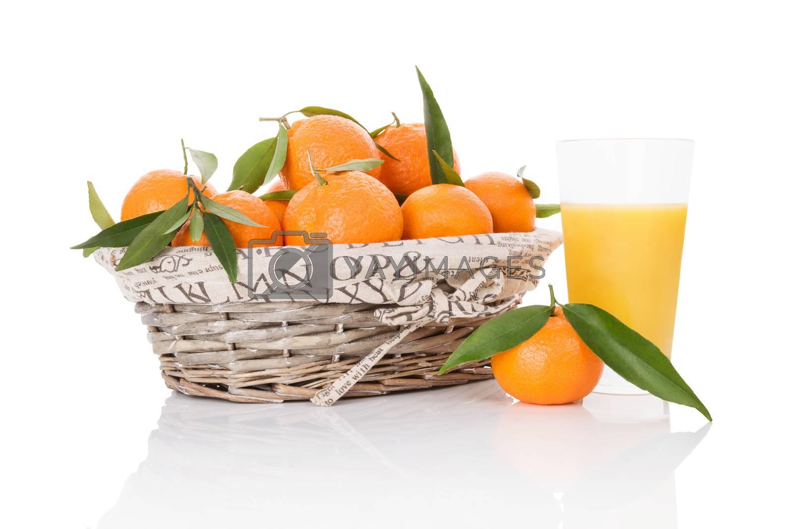 Mandarines in white wooden basket isolated on white background. Fresh ripe fruit background.