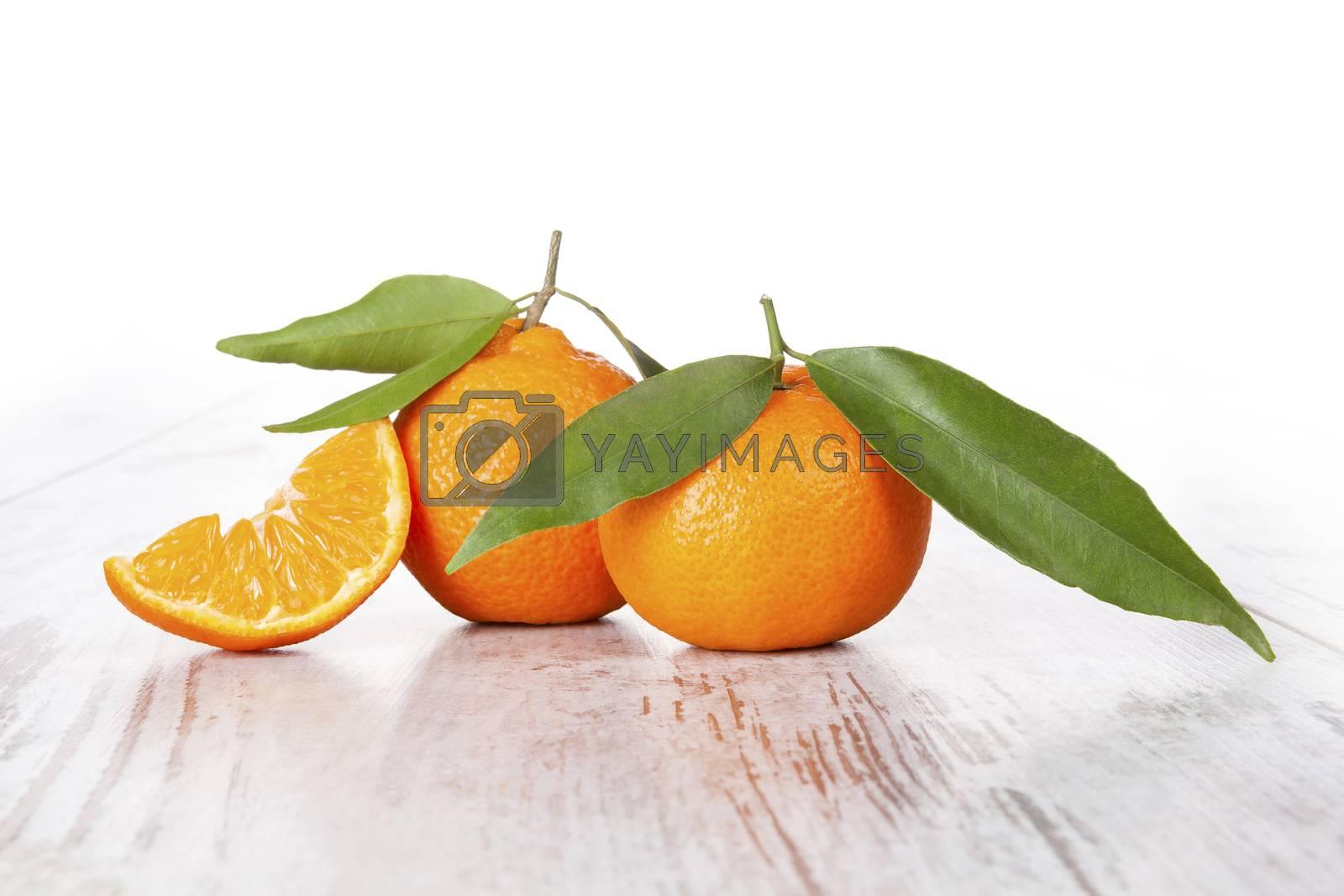 Mandarine fruit on white wooden table. Provence style.