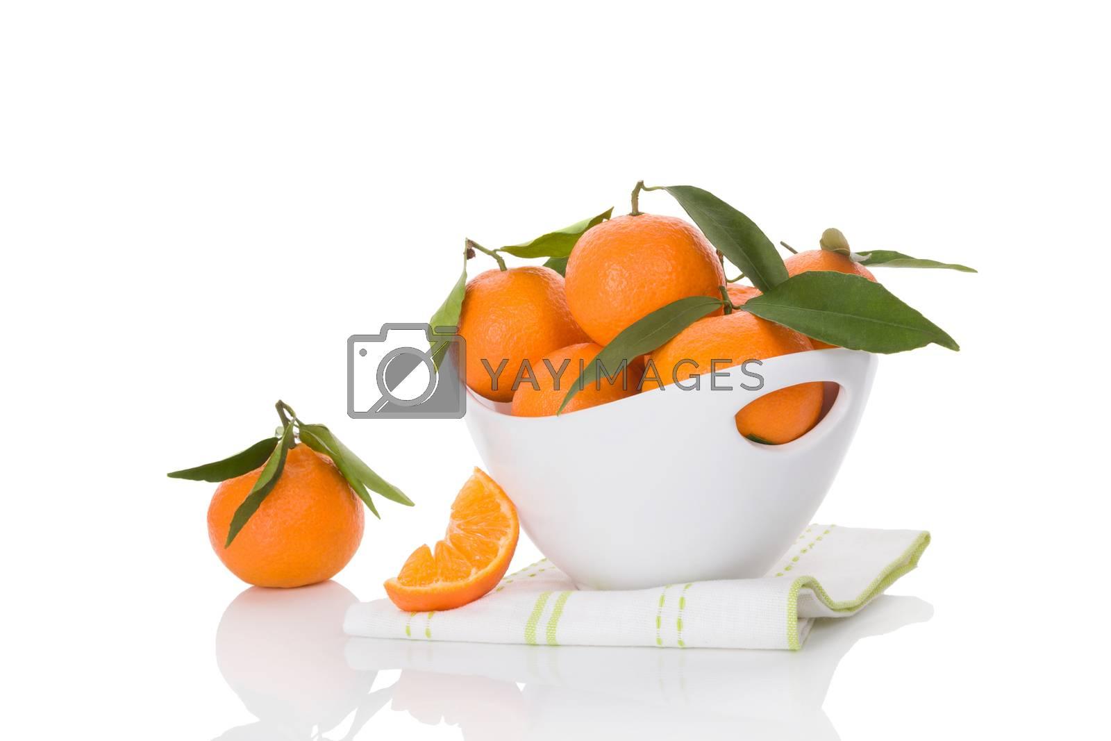 Fresh ripe mandarines in white bowl isolated on white background. Healthy fruit eating.