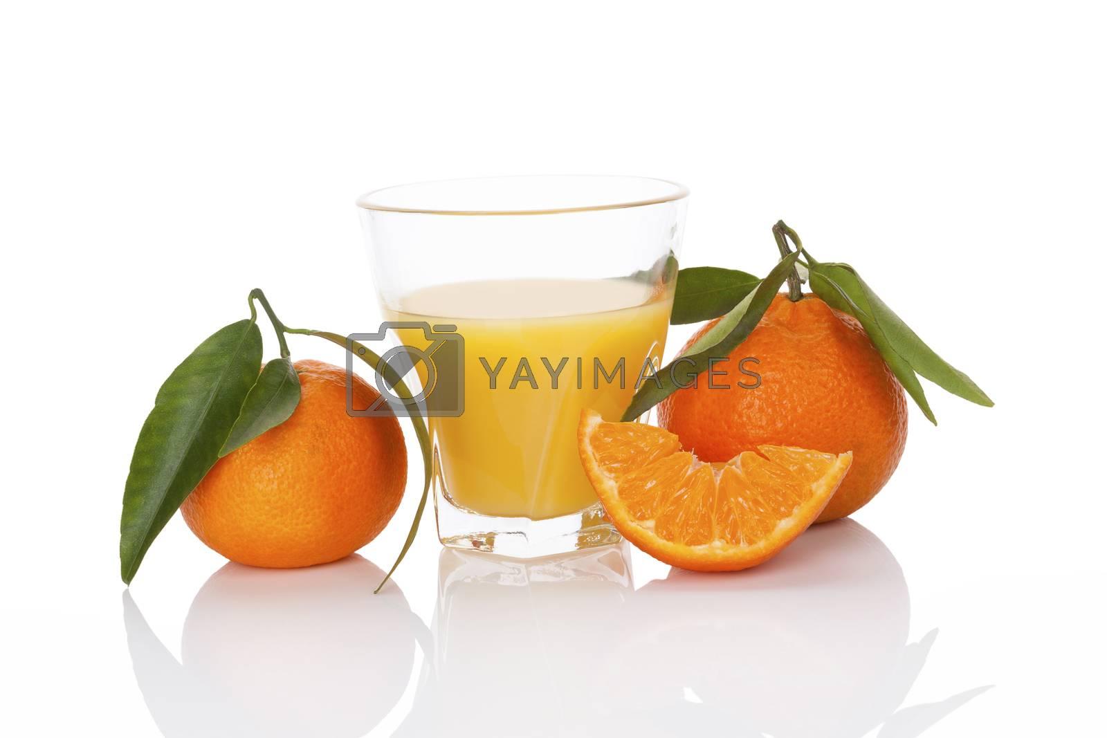 Fresh tangerine juice and ripe mandarin isolated on white background. Healthy fresh fruit juice.