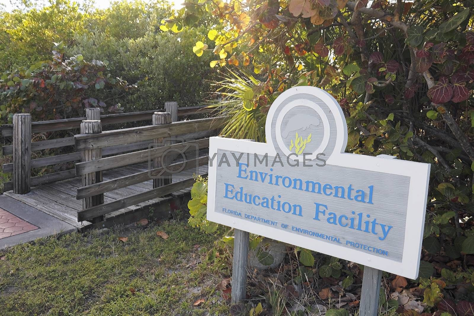 Hollywood, FL, USA - December 20, 2014: Wood foot bridge to the Environmental Education Facility at 9899 N Ocean Dr in John U Lloyd Beach State Park.