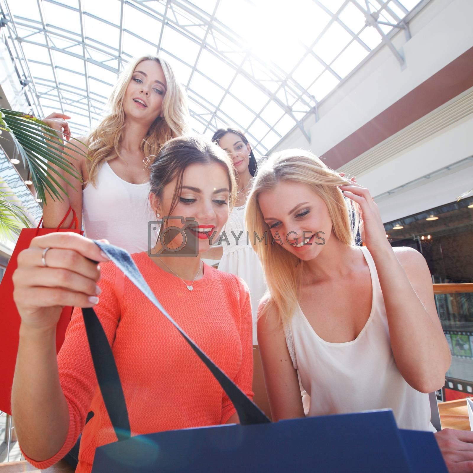 beautiful young women shopping at mall