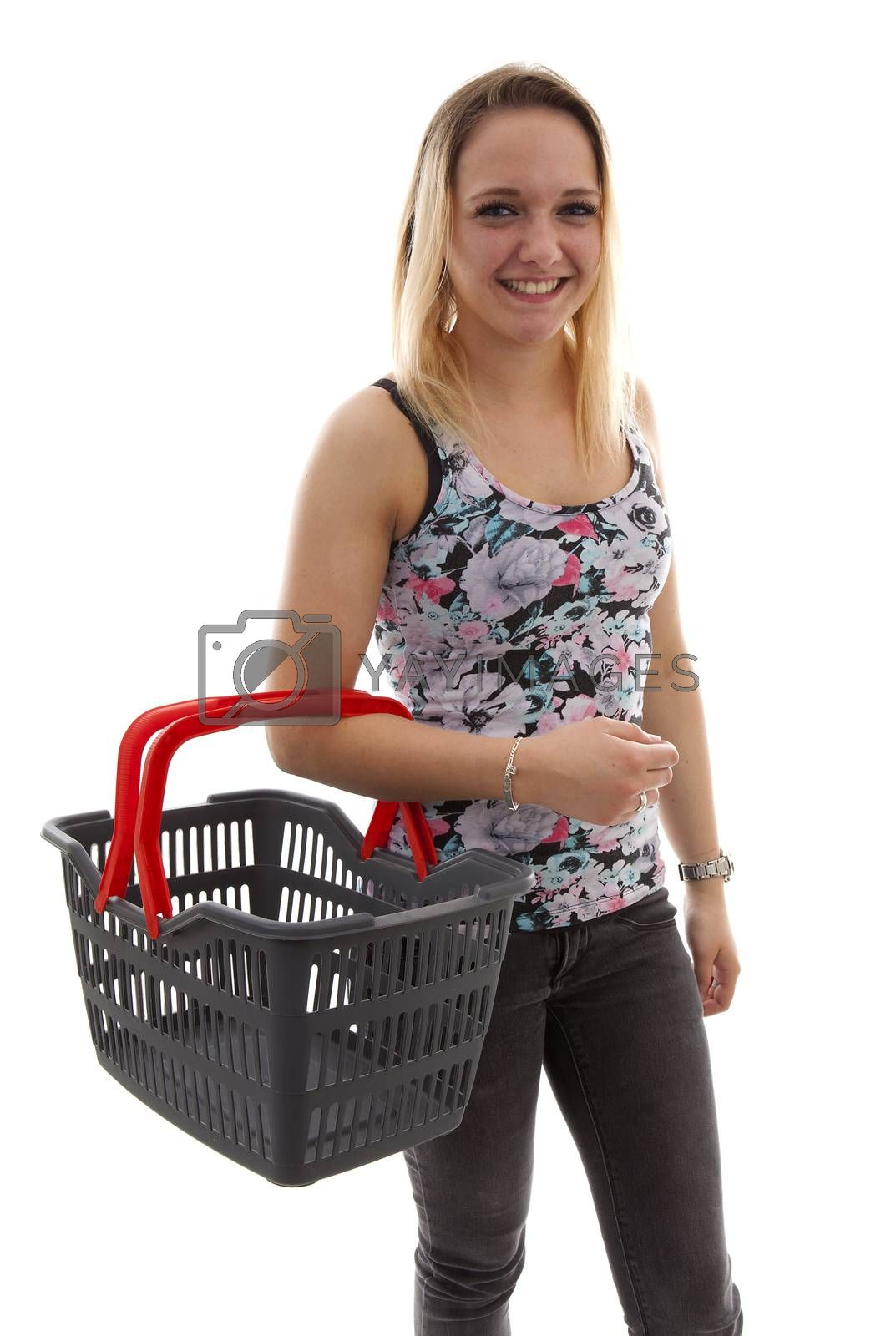 Young woman is doing grocerys with empty basket over white background