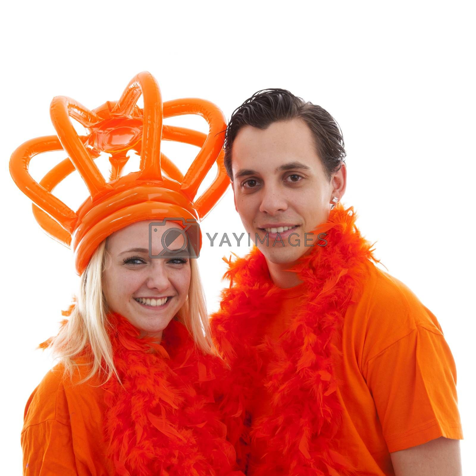 Couple of Dutch soccer supporters over white background