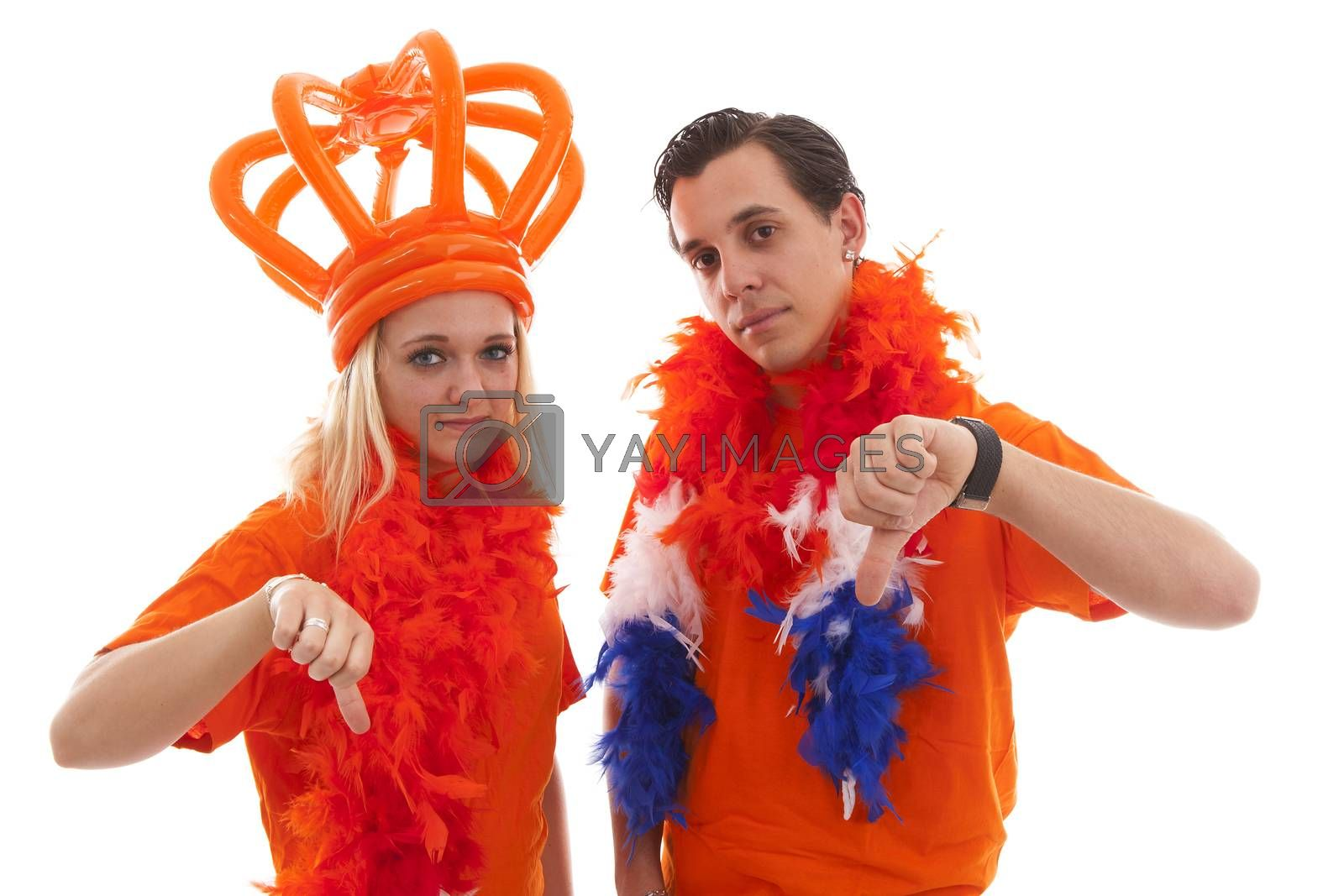 Couple of Dutch soccer supportersfeeling down over white background