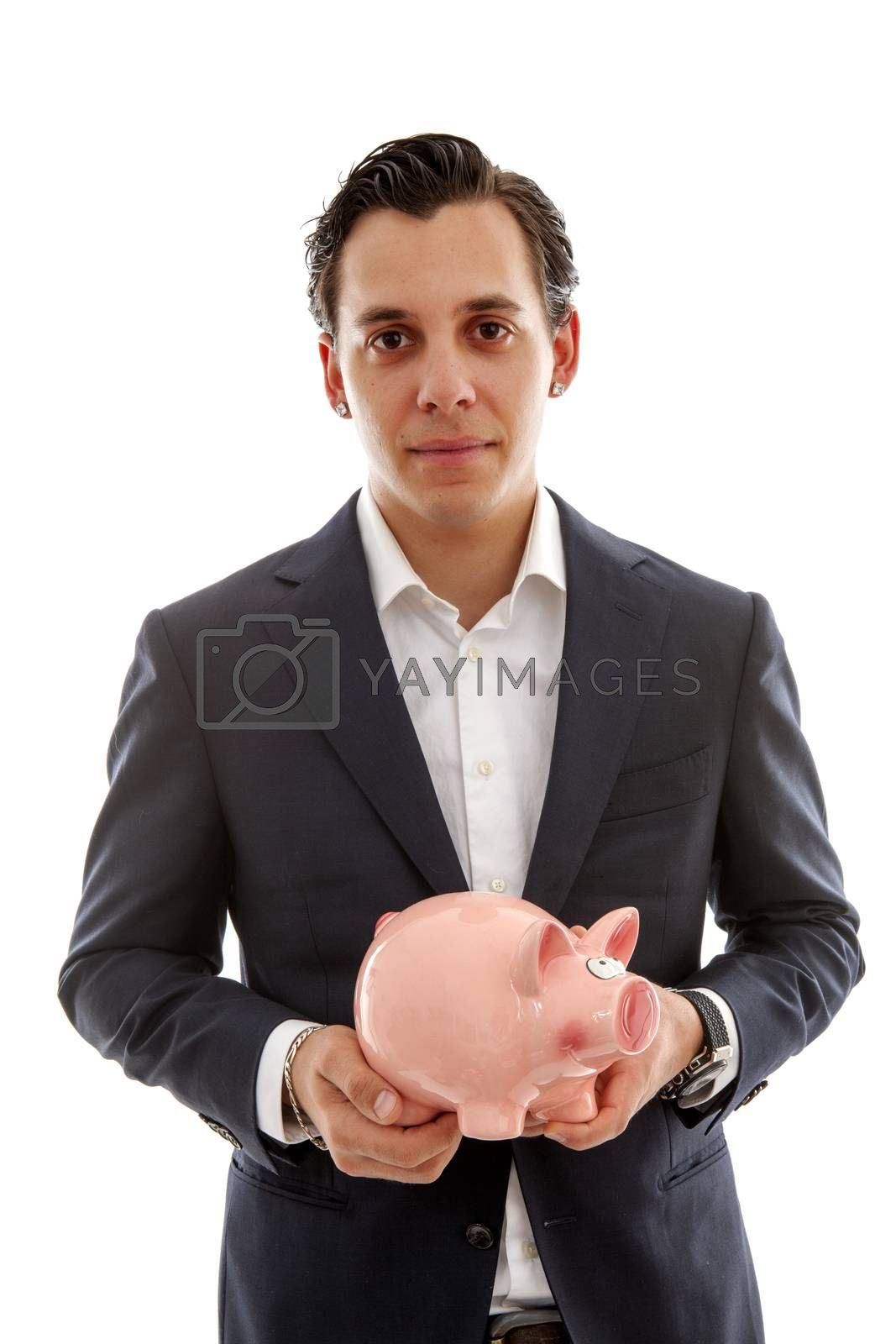 Businessman is holding piggy bank over white background