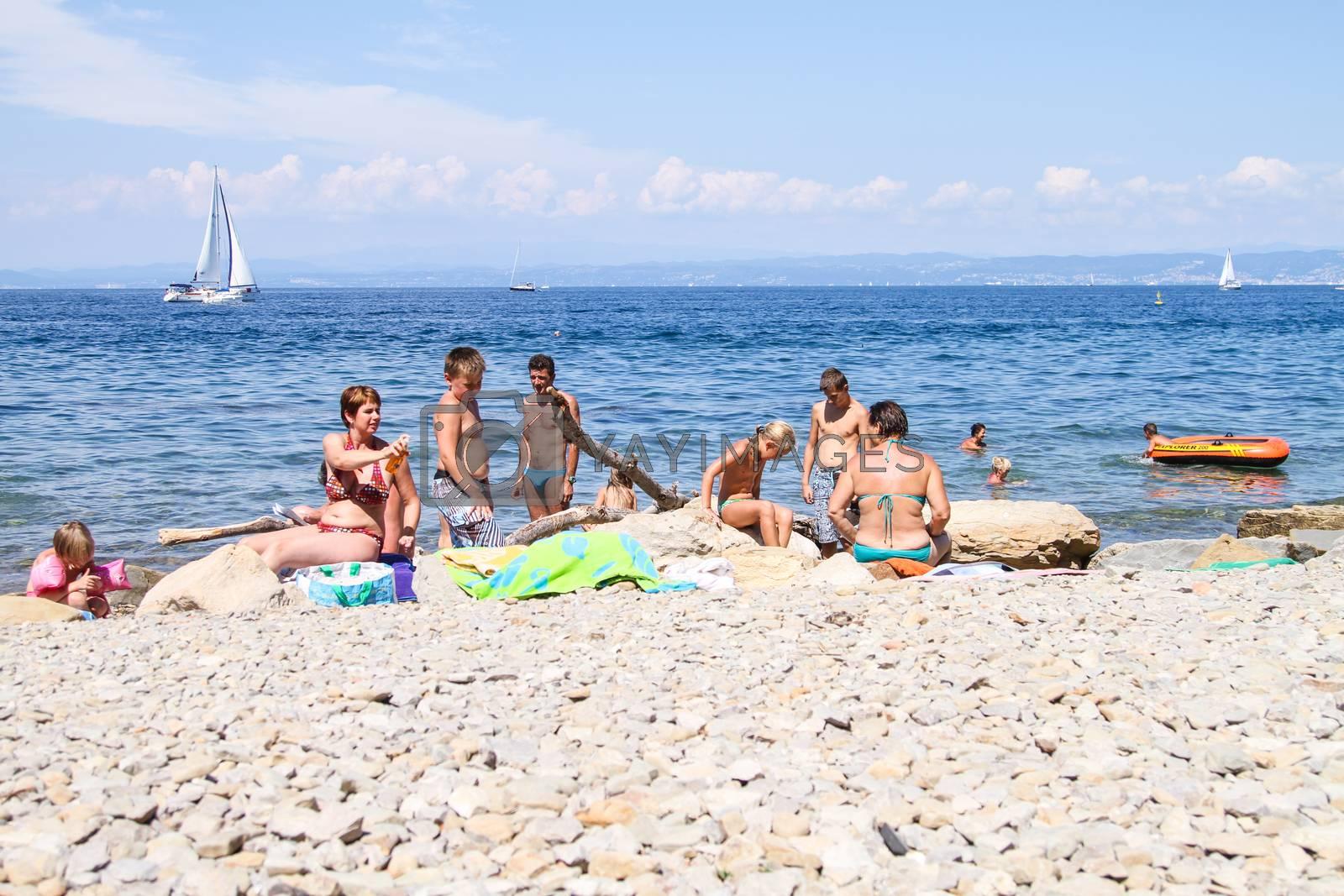 Sunbathing on a beach in Piran, Slovenia