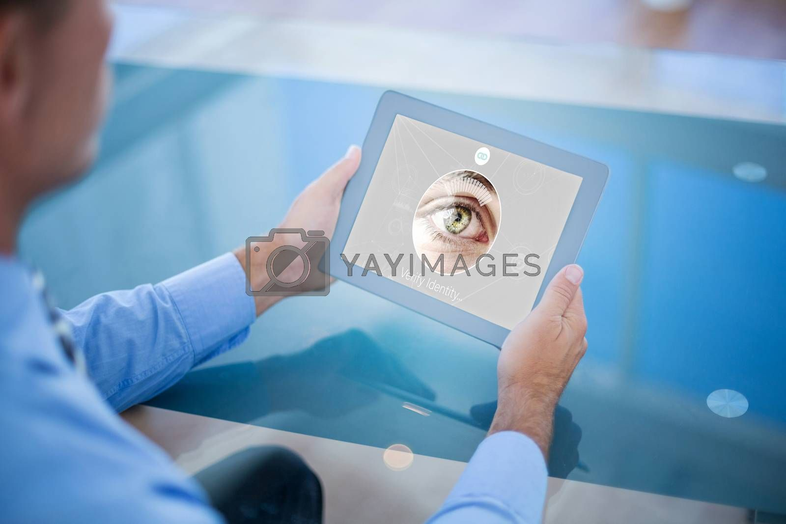 Royalty free image of Composite image of businessman using his tablet  by Wavebreakmedia