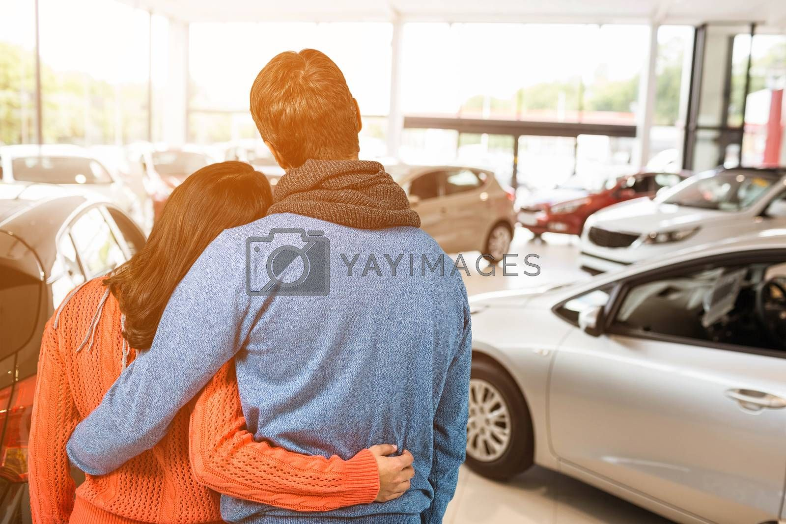 Composite image of rear view of couple against white background by Wavebreakmedia
