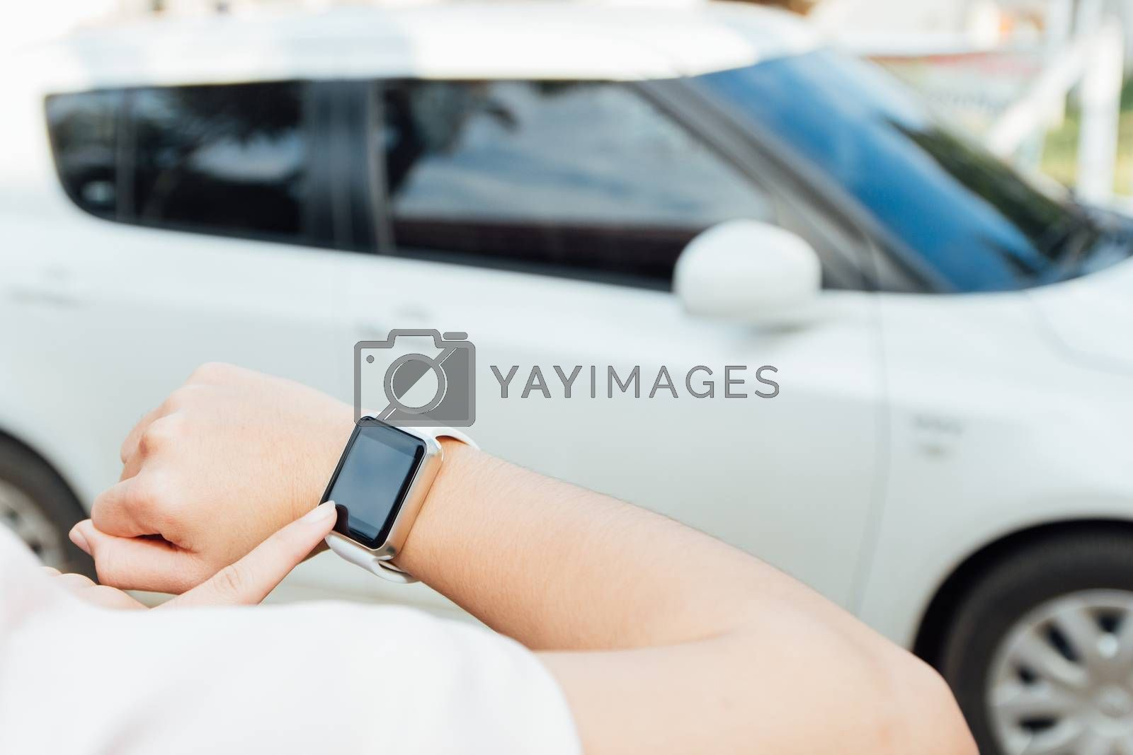 female hand touching on smartwatch