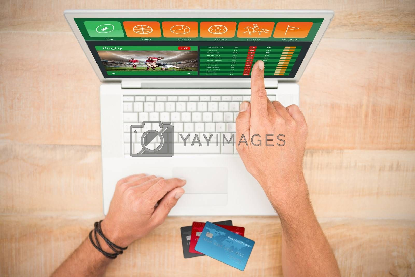 Colorful world credit cards against hand pointing on blank laptop screen