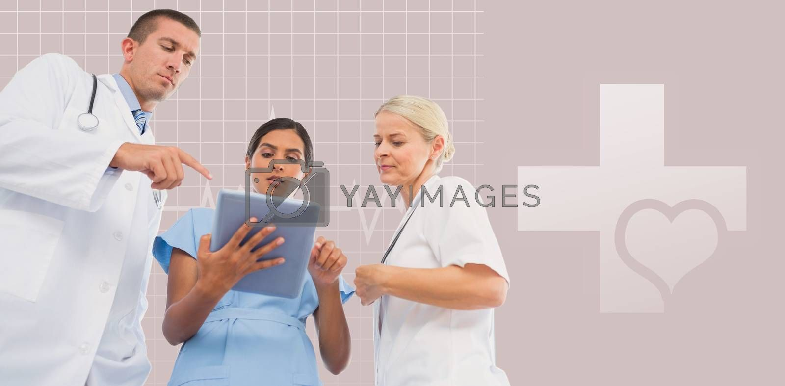 Doctors looking together at tablet against green background