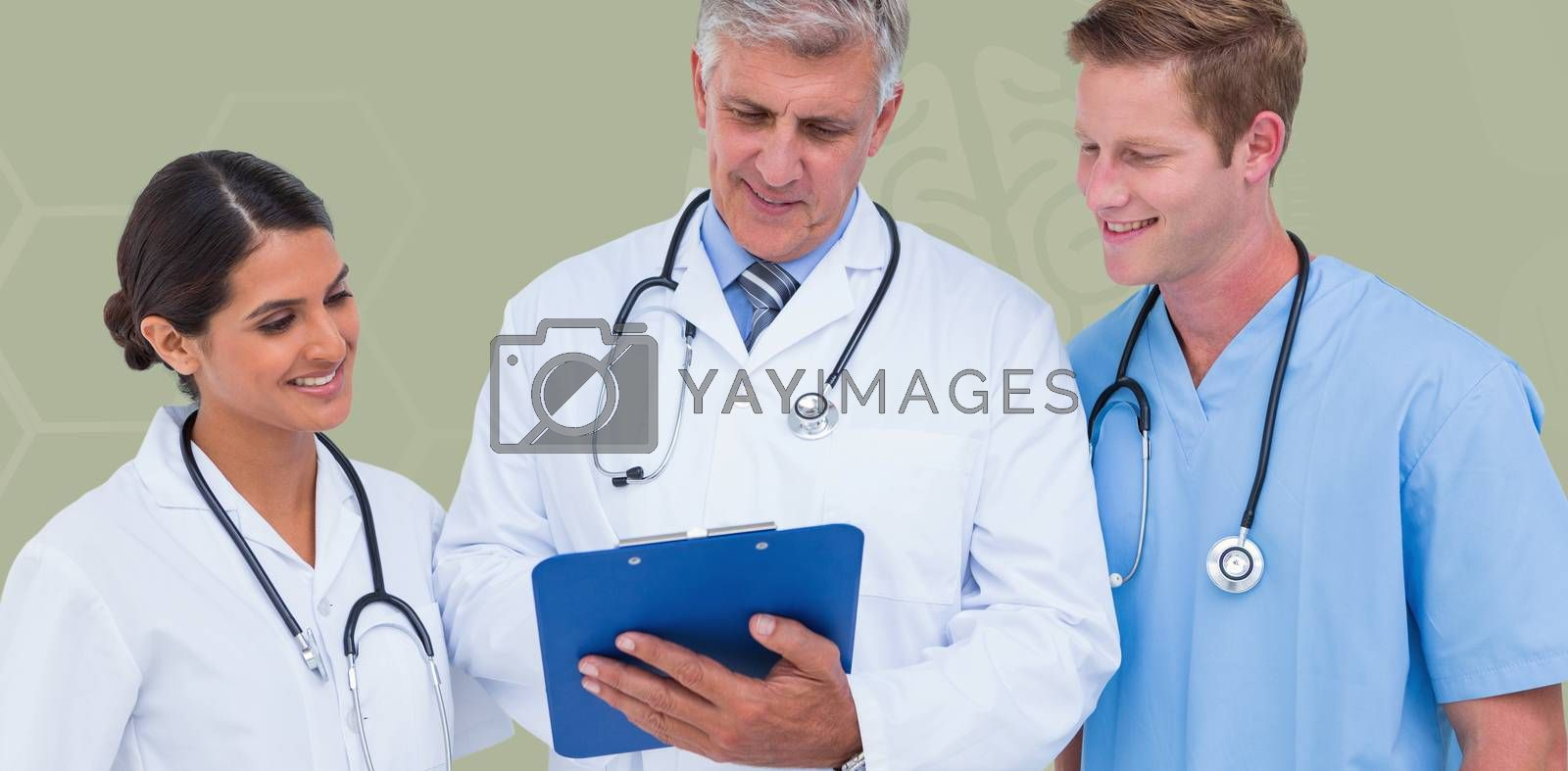 Doctor working with colleagues while holding writing pad  against blue