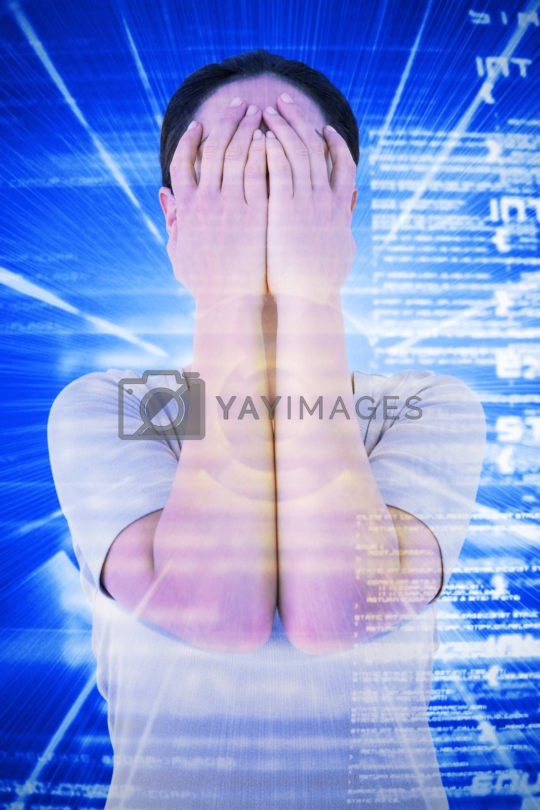 Sad woman hiding her face against blue background with coding