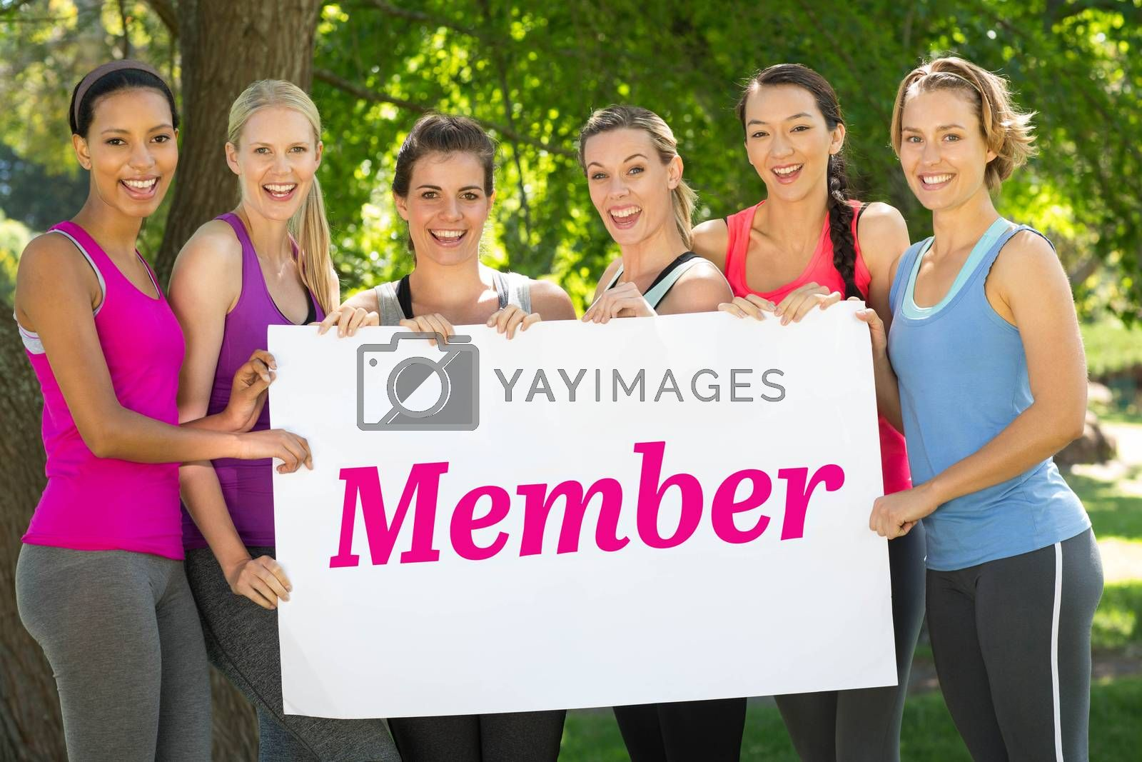 The word member and white wall against fitness group holding poster in park