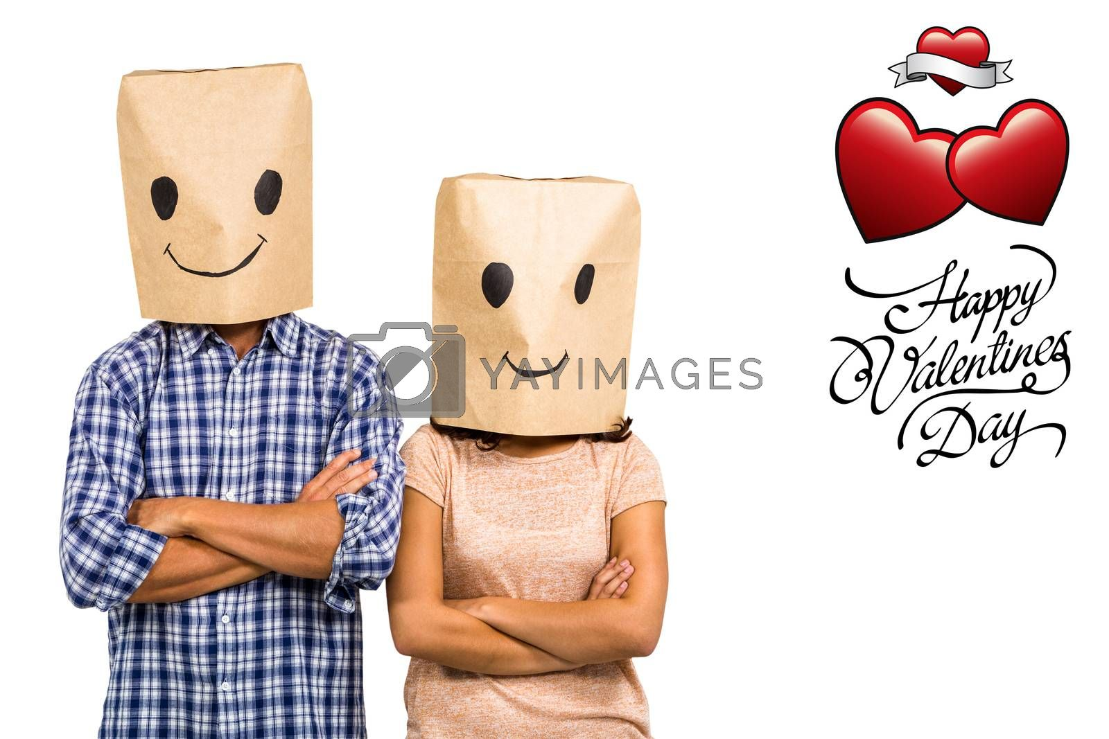 Couple with arms crossed wearing smiley paper bags against valentines day greeting