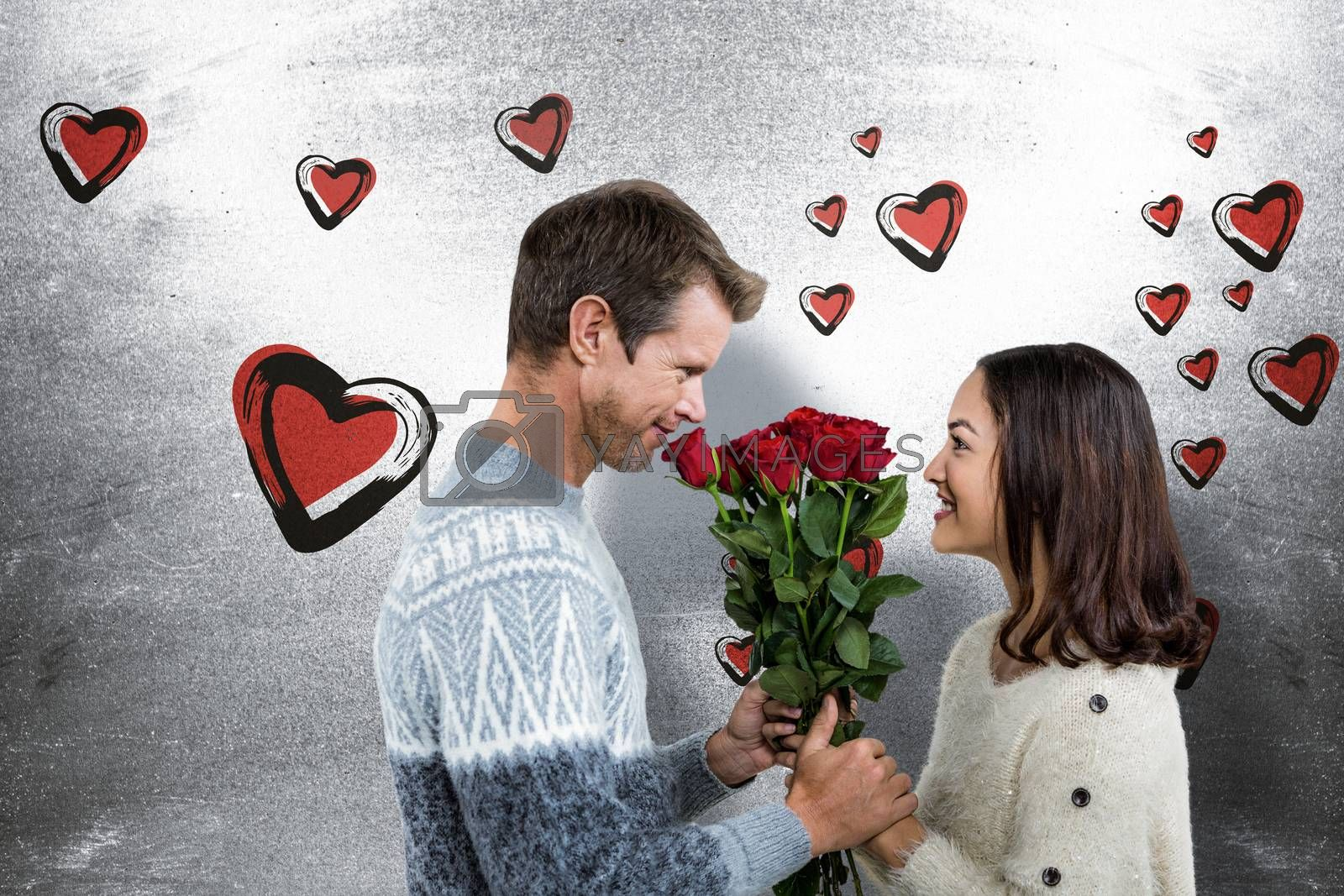 Composite image of romantic couple holding red roses by Wavebreakmedia