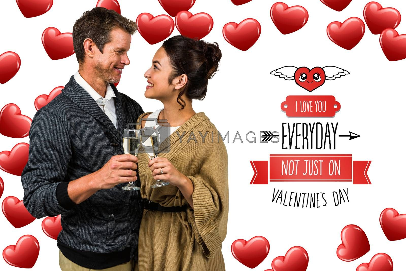 Composite image of happy romantic couple with champagne flute by Wavebreakmedia