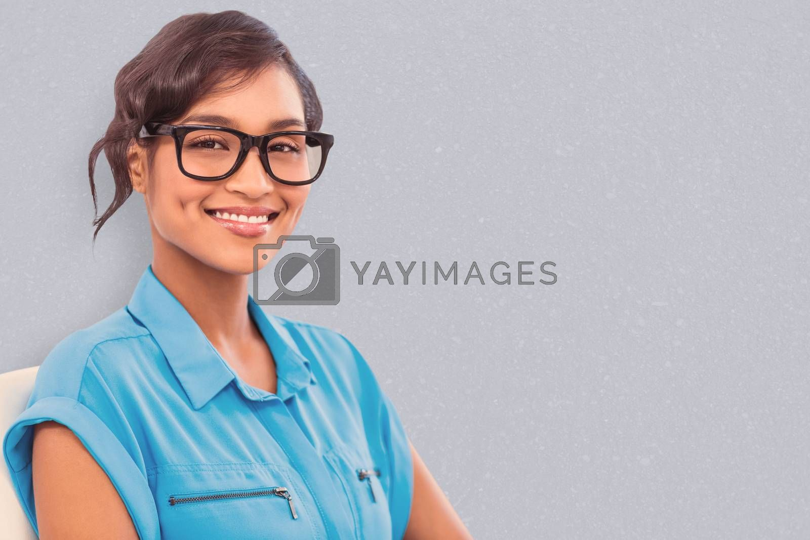 Portrait of smiling businesswoman wearing reading glasses against road