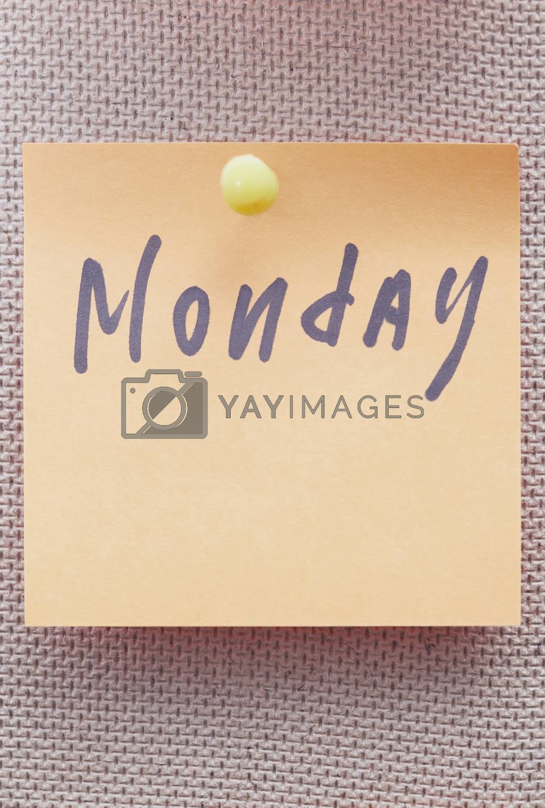 Adhesive note with Monday text on a bulletin board