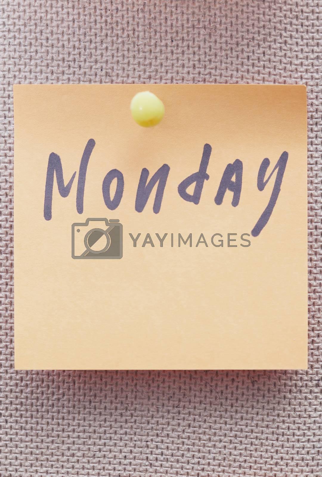 Monday written on a sticky note by Novic