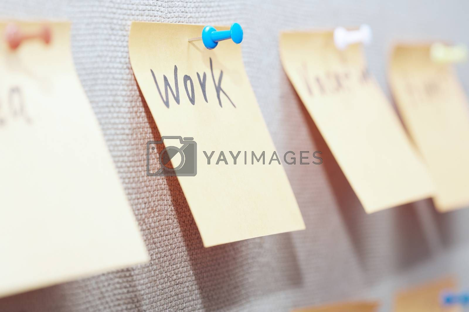 Adhesive note with Work text on a bulletin board