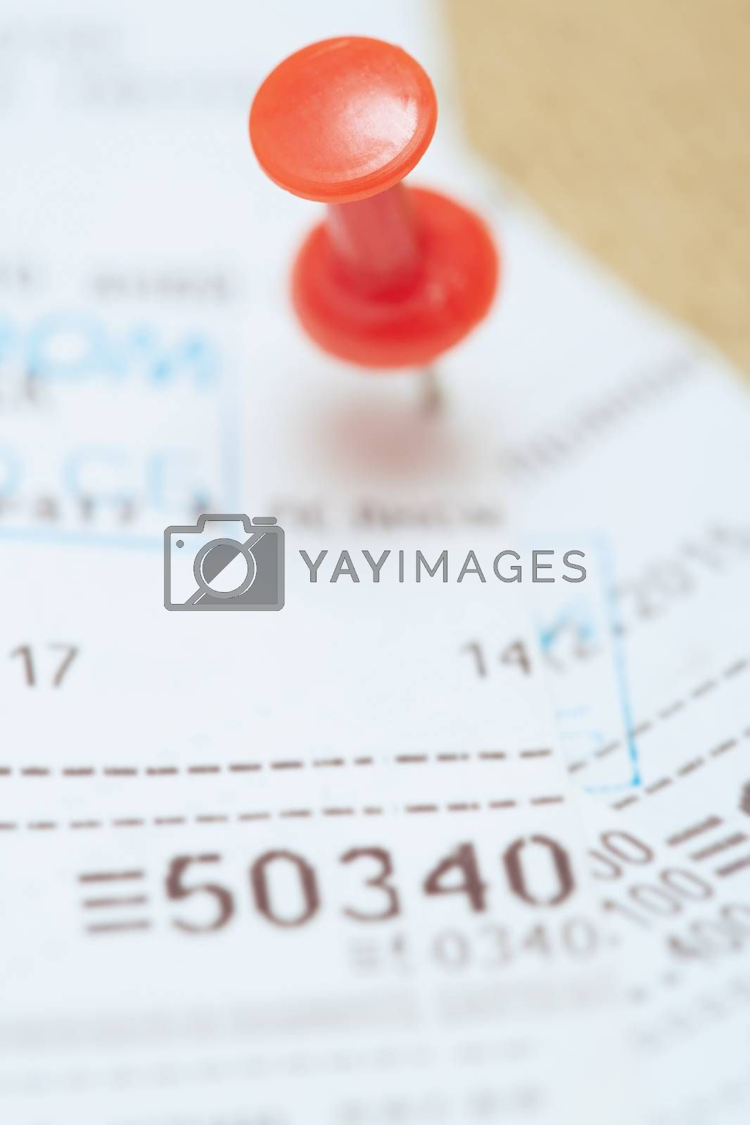 Cash register with pushpin. Close-up photo