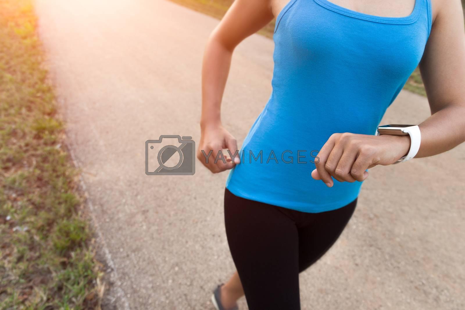 closeup woman running on rural road during sunset