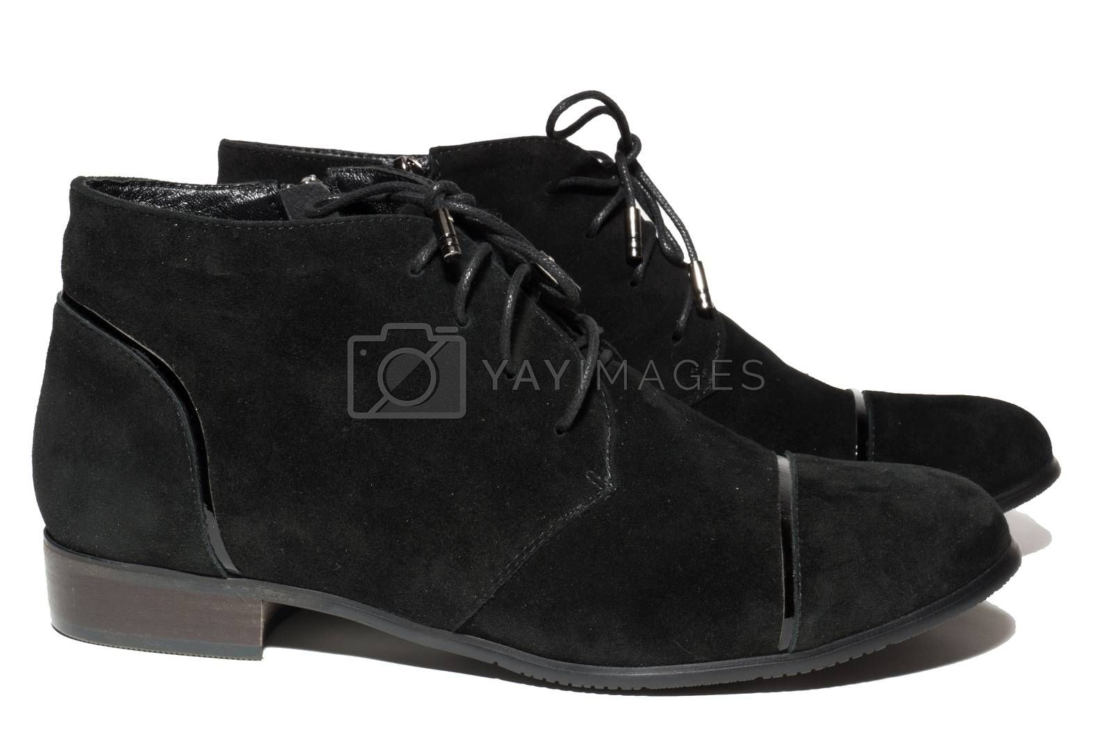 The photo shows winter boots on a white background