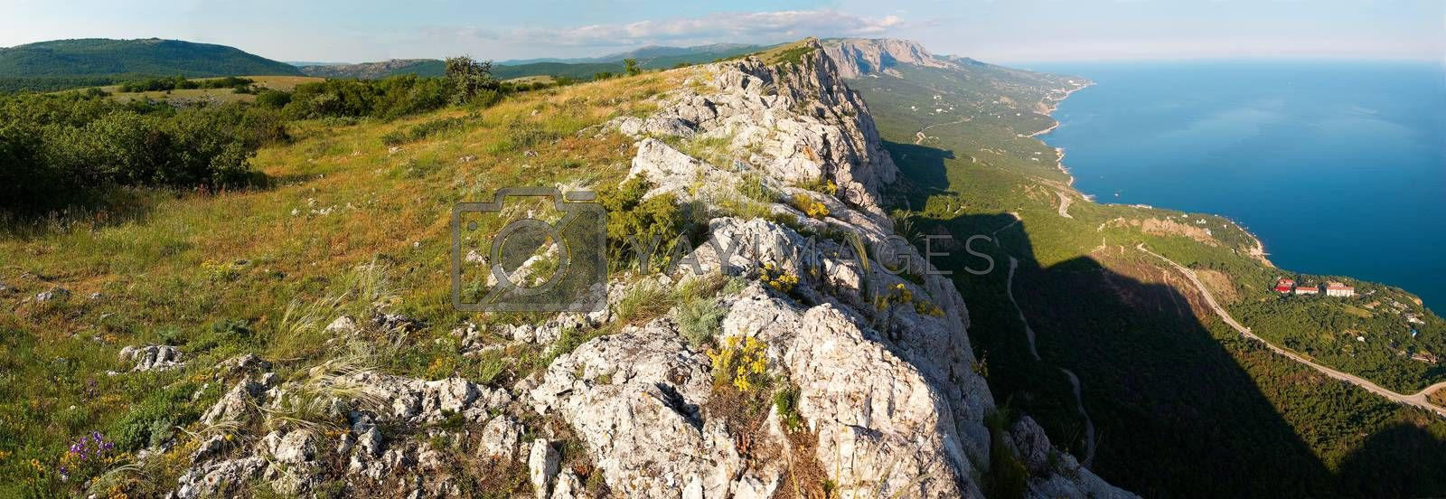 Royalty free image of View from the top of the mountain to the steep. Wide-angle panor by vapi