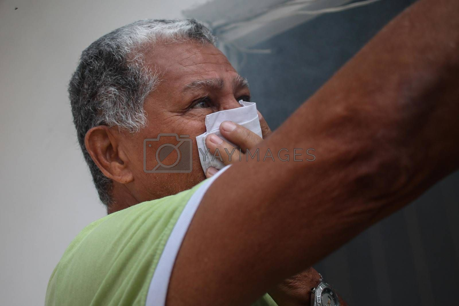 VENEZUELA, Caracas: A resident of Caracus, Venezuela protects himself from smoke as fumigation crews work to exterminate mosquitoes carrying the Zika virus in the slums of Caracas, Venezuela on February 3, 2016. As of February 4, there have been reports of at least 255 cases of the rare Guillain-Barre syndrome — which causes the immune system to attack the nerves — potentially linked to the Zika virus in Venezuela.