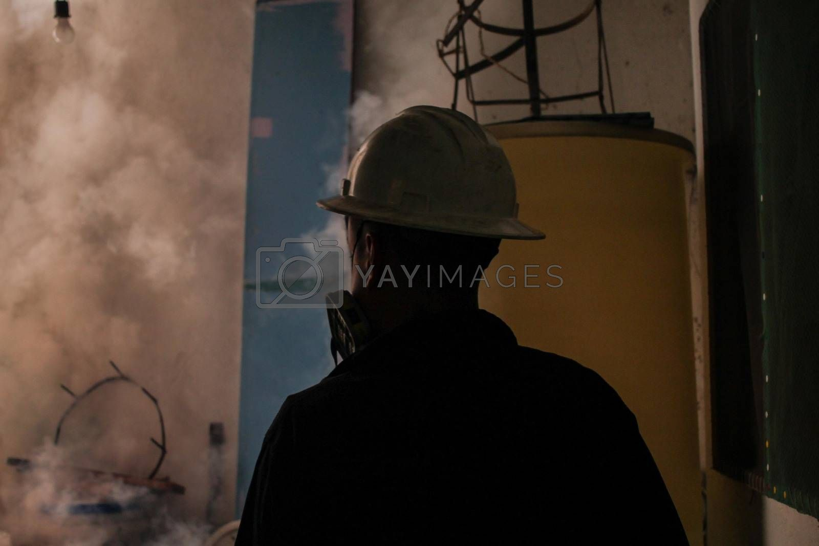 VENEZUELA, Caracas: A member of a fumigation crew works to exterminate Aedes mosquitoes carrying the rapidly spreading Zika virus in the slums of Caracas, Venezuela on February 3, 2016. As of February 4, there have been reports of at least 255 cases of the rare Guillain-Barre syndrome — which causes the immune system to attack the nerves — potentially linked to the Zika virus in Venezuela.