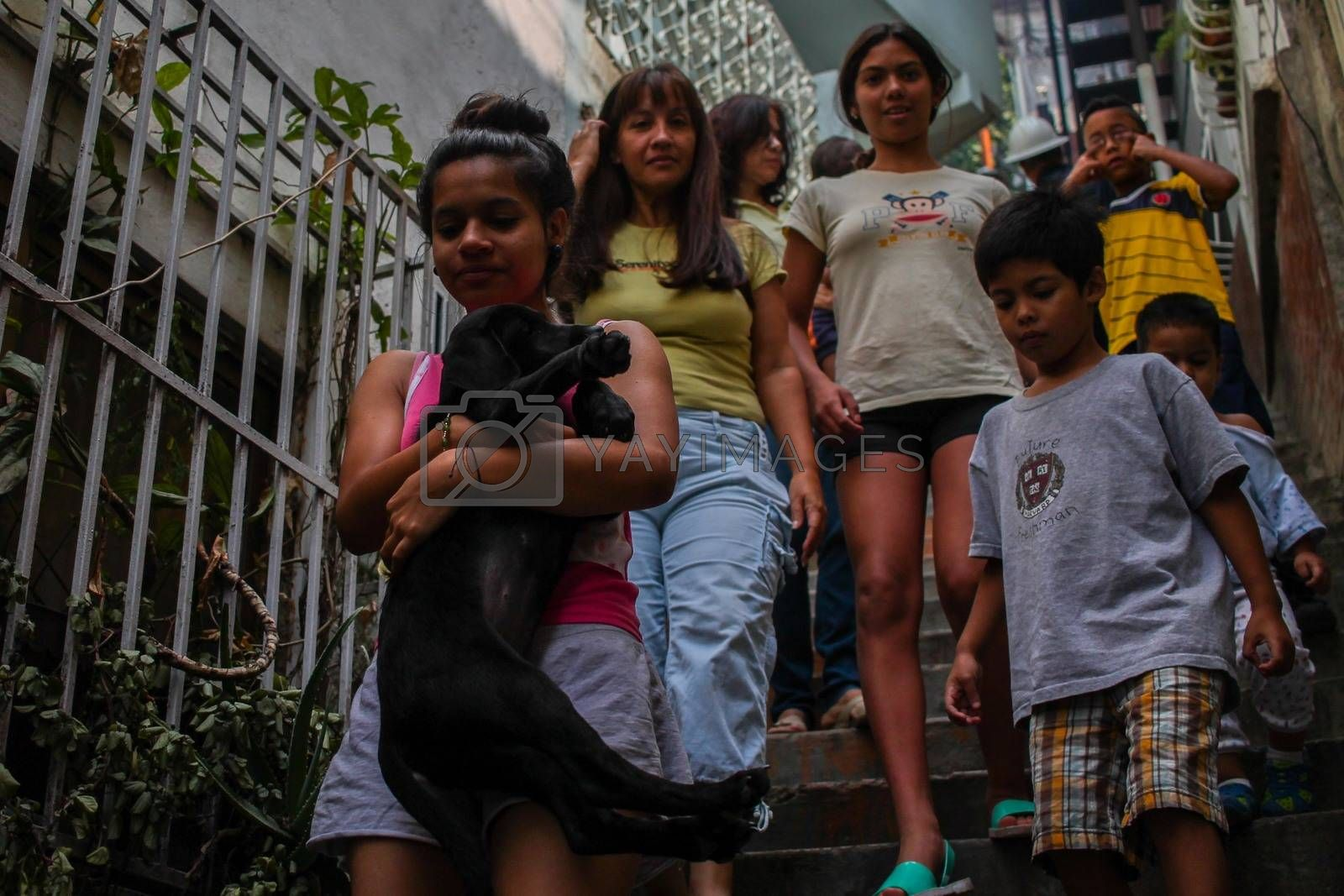 VENEZUELA, Caracas: Children exit their homes to allow for the extermination of Aedes mosquitoes carrying the Zika virus in the slums of Caracas, Venezuela on February 3, 2016. As of February 4, there have been reports of at least 255 cases of the rare Guillain-Barre syndrome — which causes the immune system to attack the nerves — potentially linked to the Zika virus in Venezuela.