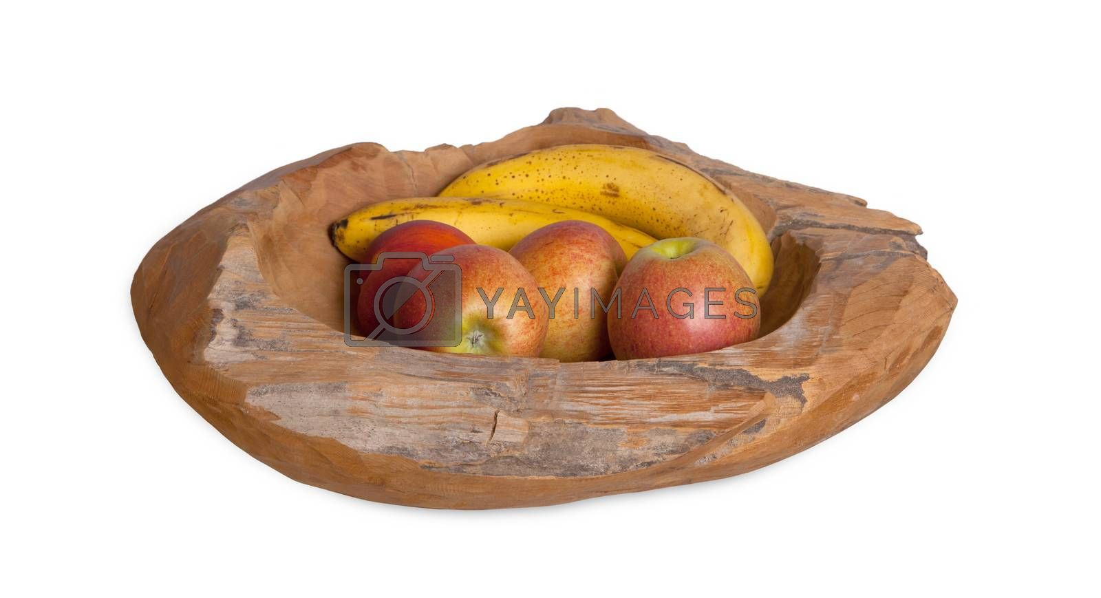 Ripe fruit assortment in a wooden bowl isolated on white