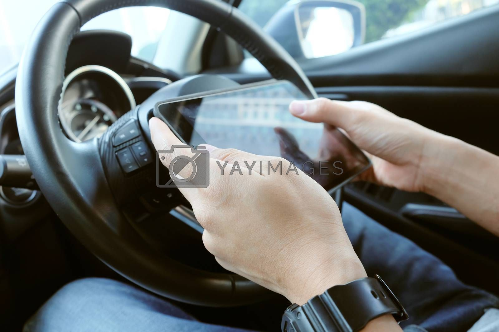 image of using a digital tablet inside of a car.